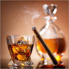 Cigar on glass of whiskey with ice cubes