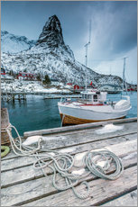 Sticker mural  A boat moored in the cold sea in the background the snowy peaks. Reine. Lofoten Islands Northern Nor - Roberto Moiola