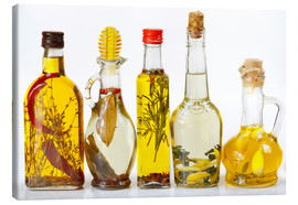 Tableau sur toile  Homemade olive oil with spices and herbs