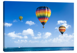 Tableau sur toile  Colorful hot air balloons on the blue sea