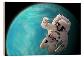 Tableau en bois  Artist's concept of an astronaut floating in outer space by a water covered planet. - Marc Ward