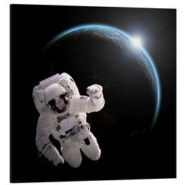 Tableau en aluminium  Astronaut floating in space as the sun rises on to Earth-like planet. - Marc Ward
