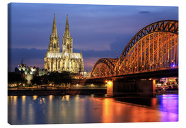 Tableau sur toile  Cologne Cathedral and Hohenzollern Bridge at night - Oliver Henze