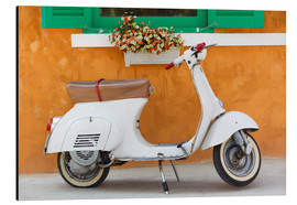 White scooter in front of a window