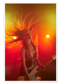Rock girl playing the electric guitar