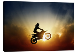 Toile  Biker jumping at sunset