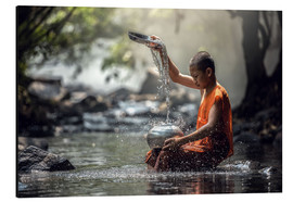 Monk washing dishes