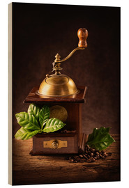Bois  Coffee mill with beans and green leaves and a cup of coffee - Elena Schweitzer
