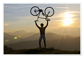 Poster  Man holding a racing bike above his head - imageBROKER