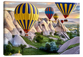 Tableau sur toile  Hot air balloons over Goreme tuff rock formations