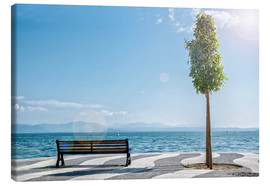 Tableau sur toile  Shore of Lake Garda with Alps on the horizon