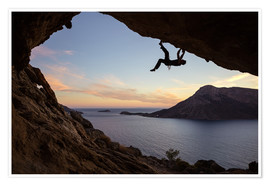 Poster  Climber in a cave at sunset