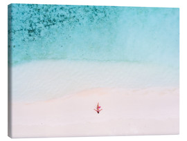Tableau sur toile  Drone view of woman on the beach, Maldives - Matteo Colombo