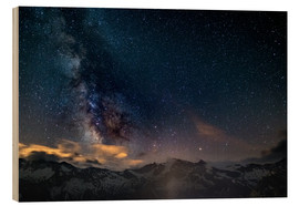 Tableau en bois  The Milky Way galaxy glowing over snowcapped mountains in the Alps - Fabio Lamanna