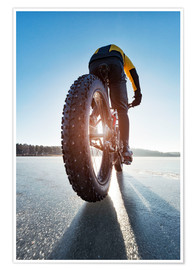 Poster  Man cycling on a frozen lake - Johner