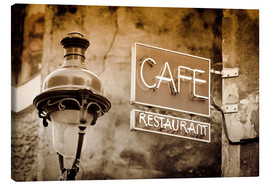 Tableau sur toile  Cafe sign and lamp post, Paris, France. - age fotostock